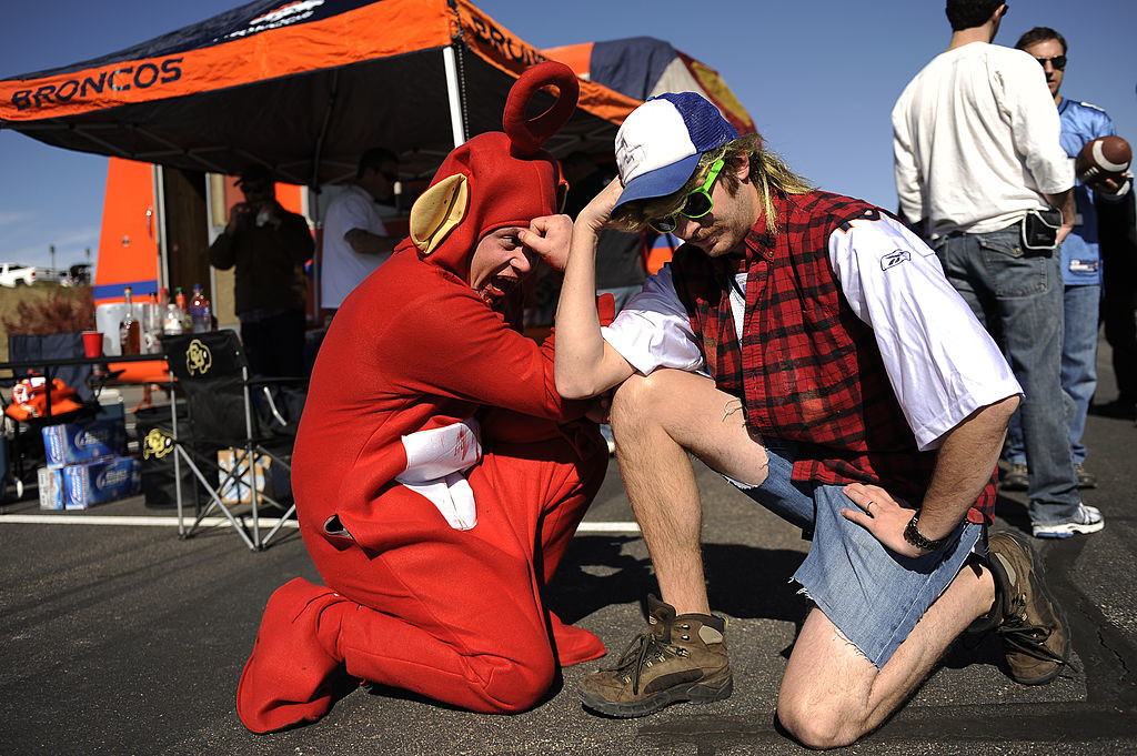 Two men Tebowing outside a Bronco's game