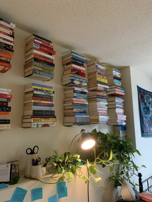 10 stacks of books using these bookshelves that look like they're floating on the wall
