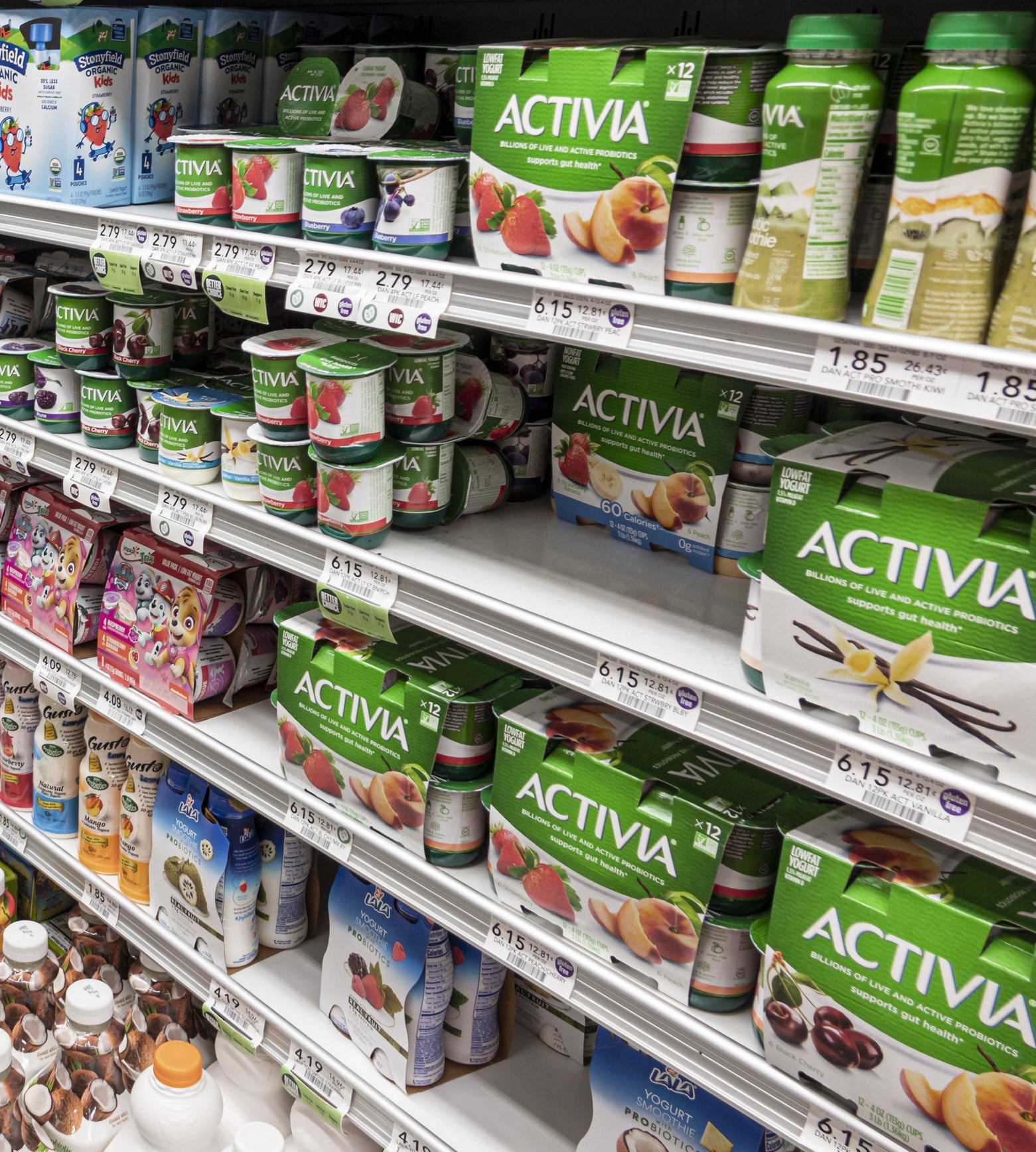 Shelves full of Activia in a grocery store
