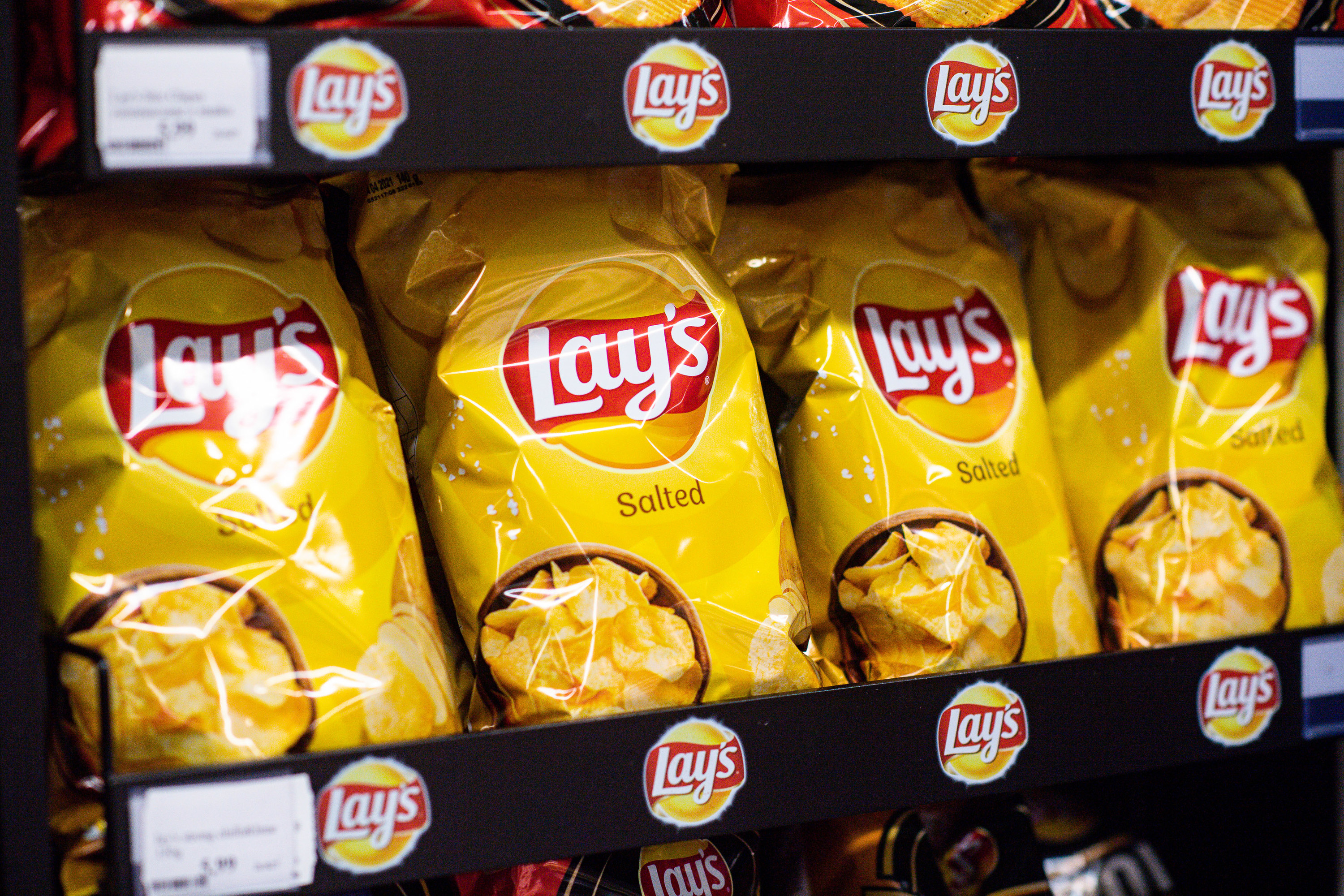 A shelf of Lay's chips in a store