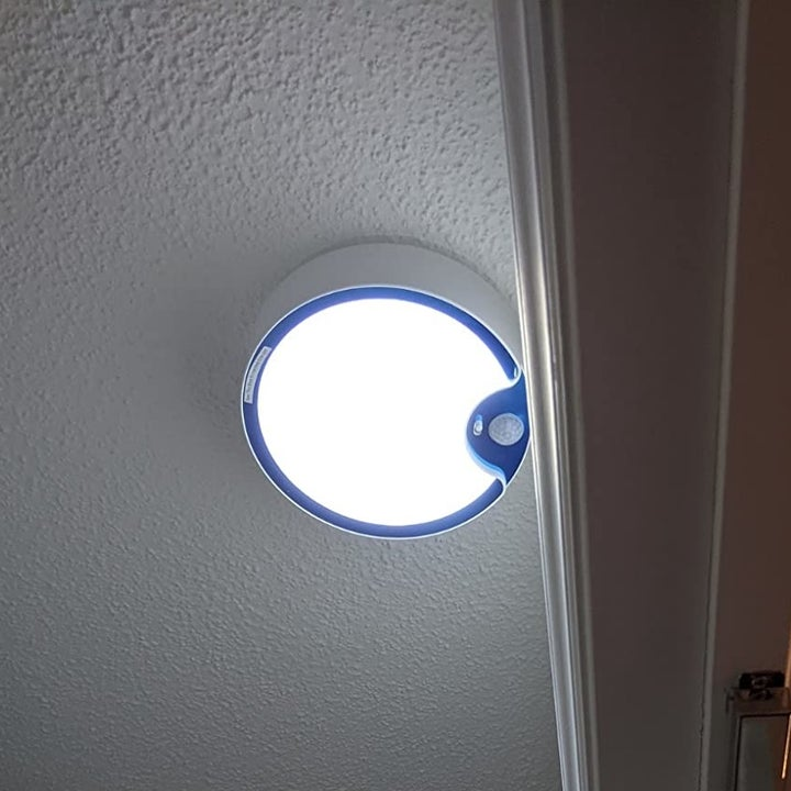 One of the illuminated lights mounted on the ceiling