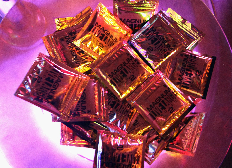 A bowl full of Magnum condoms