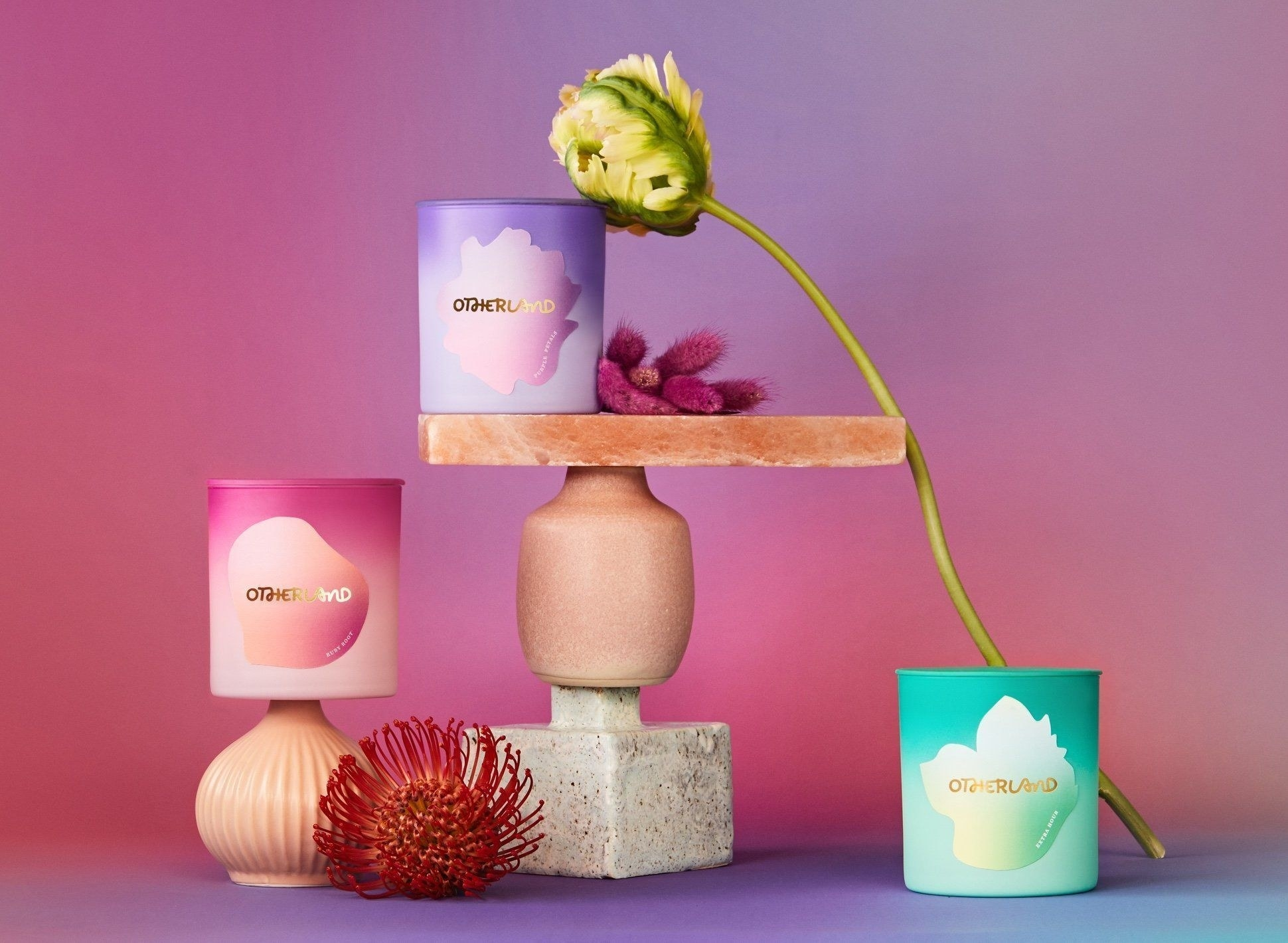 three floral inspired candles