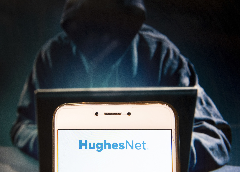 The HughesNet logo on a smartphone