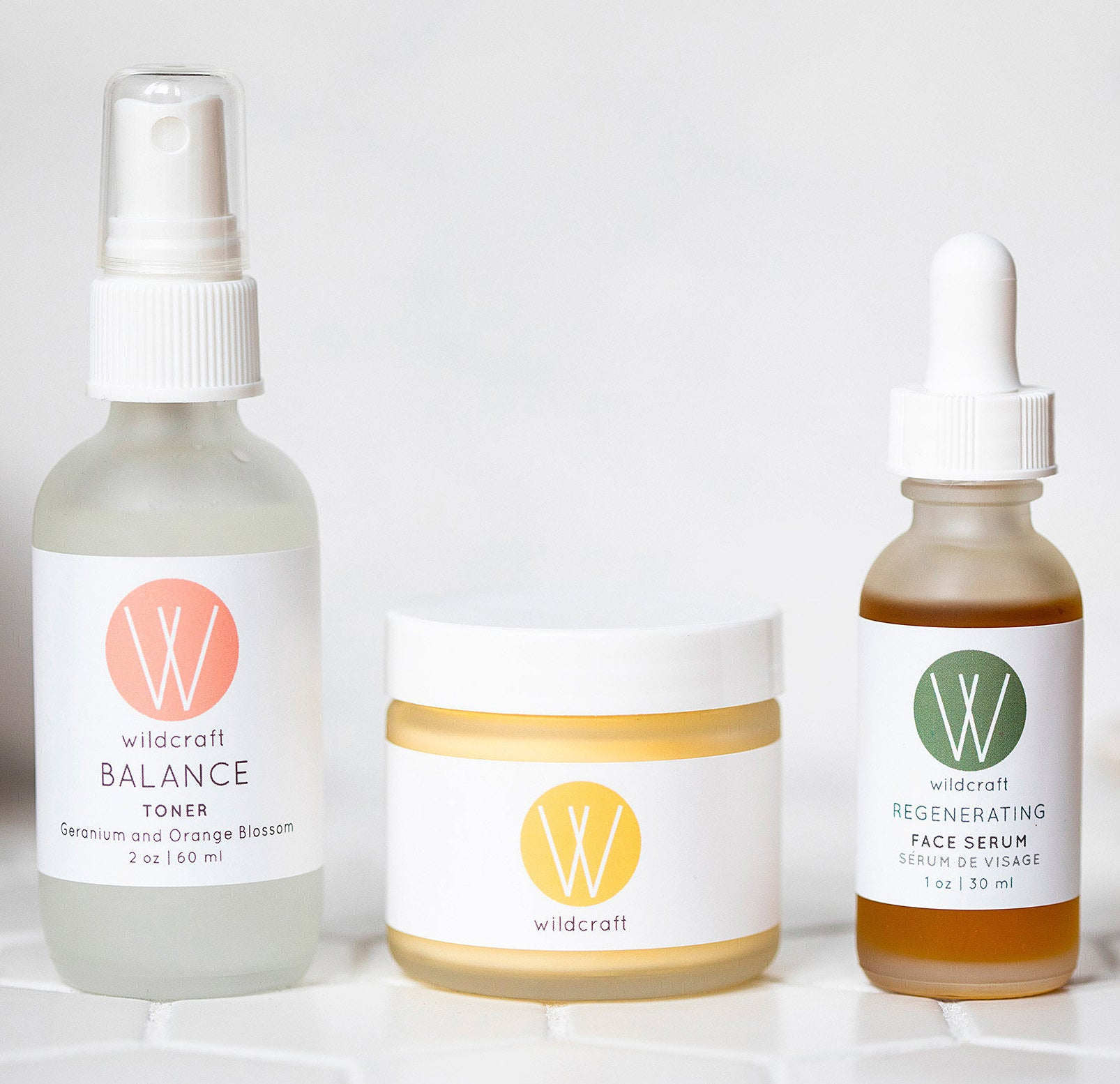 Three containers of beauty products in a row