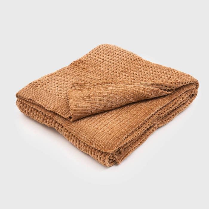 The waffle knit blanket in mustard