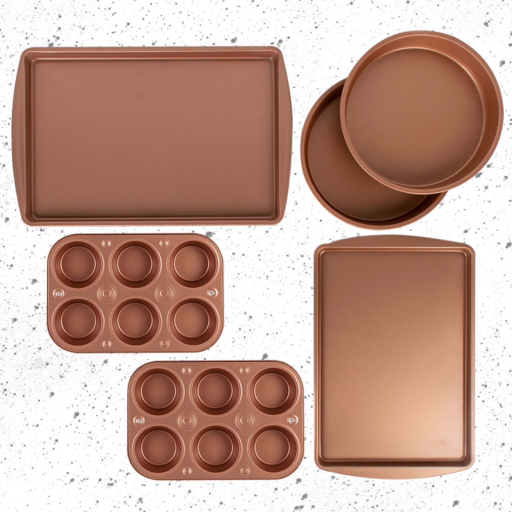 copper bakeware including two sheet pans, two round pans, and two muffin tins