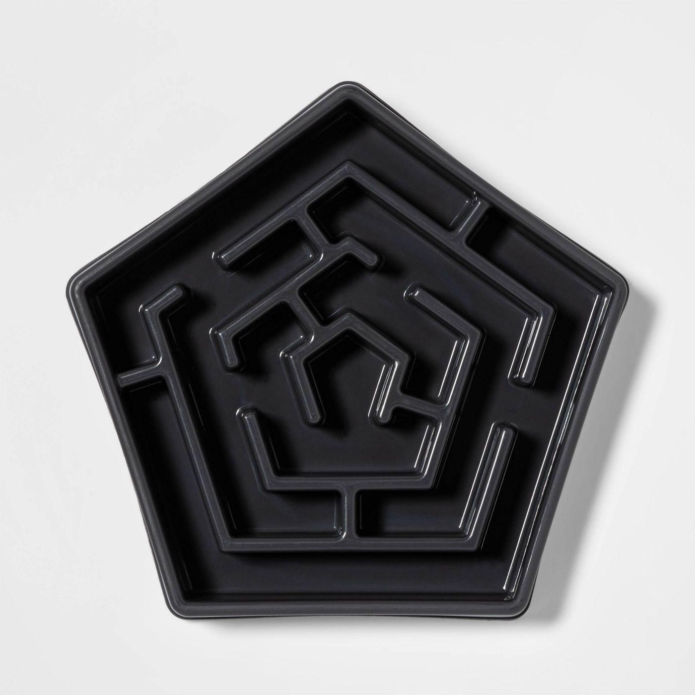 Dark gray pentagon-shaped food dish with ridges