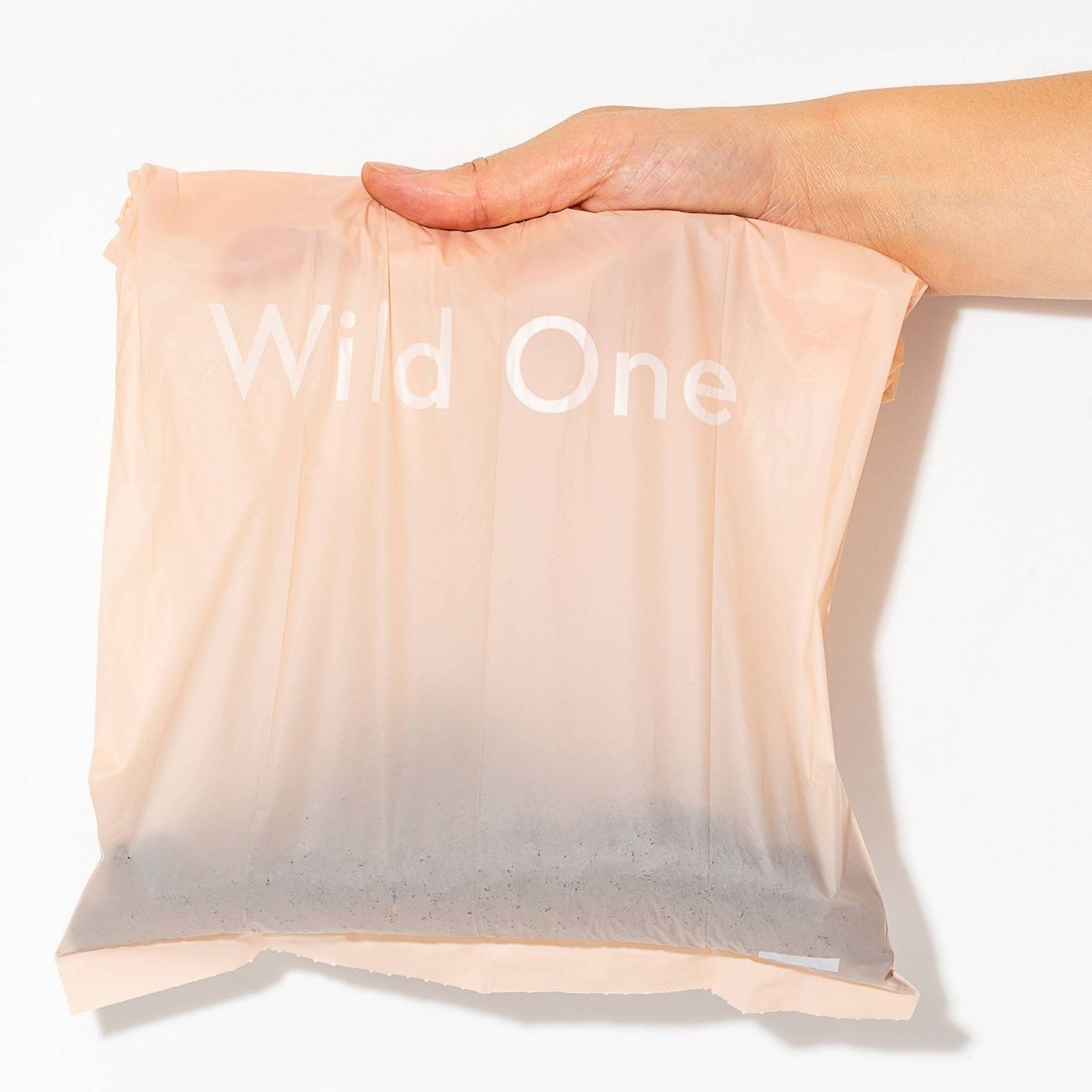Pink bag that says Wild One on it