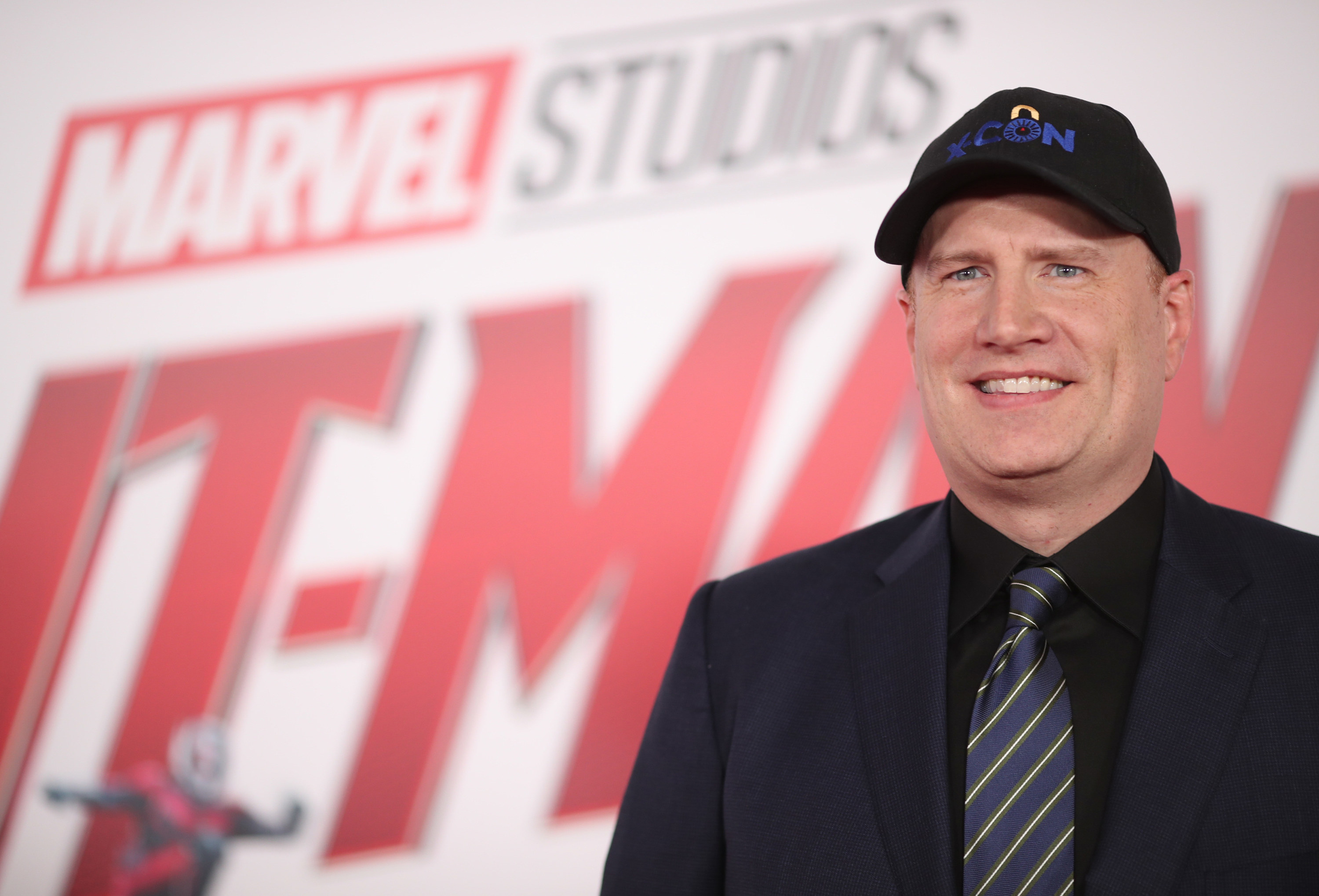 Kevin smiles at a Marvel event