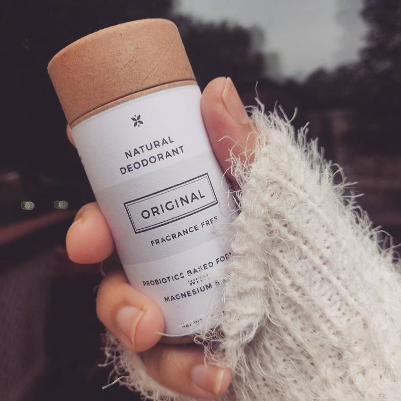 hand holding a tube of the fragrance free deo