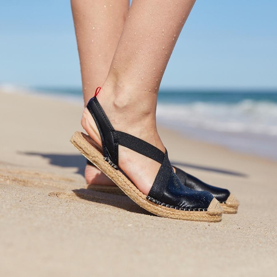 model wearing waterproof espadrilles with slingback design on the beach
