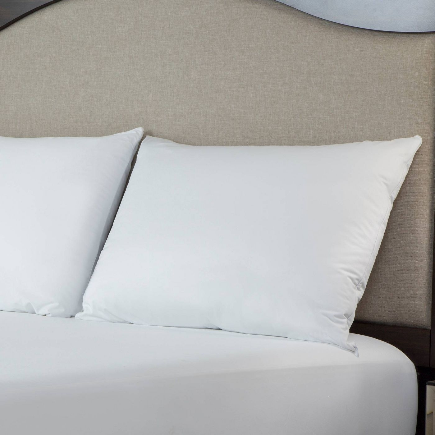 two pillows placed on bed