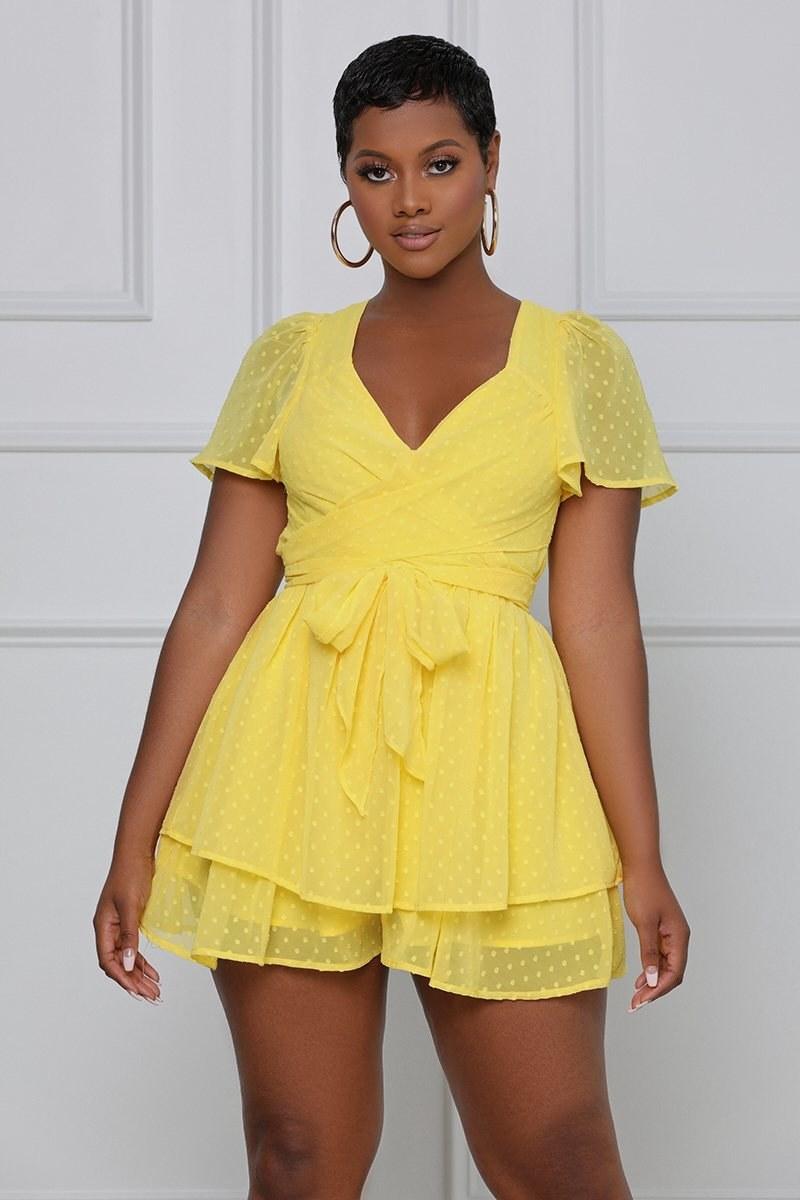 a model wearing the romper in yellow