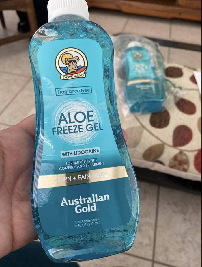 Reviewer holding bottle of blue freeze gel