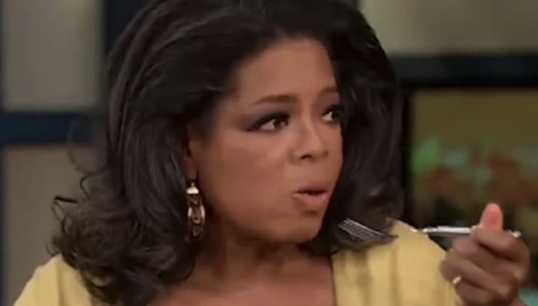 Oprah stopping mid-bite