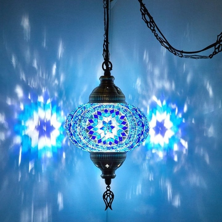 The same lamp with a blue and white mosaic glass design