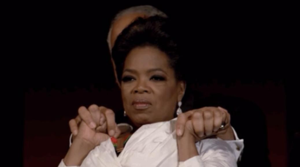 Oprah holding Stedman's hands