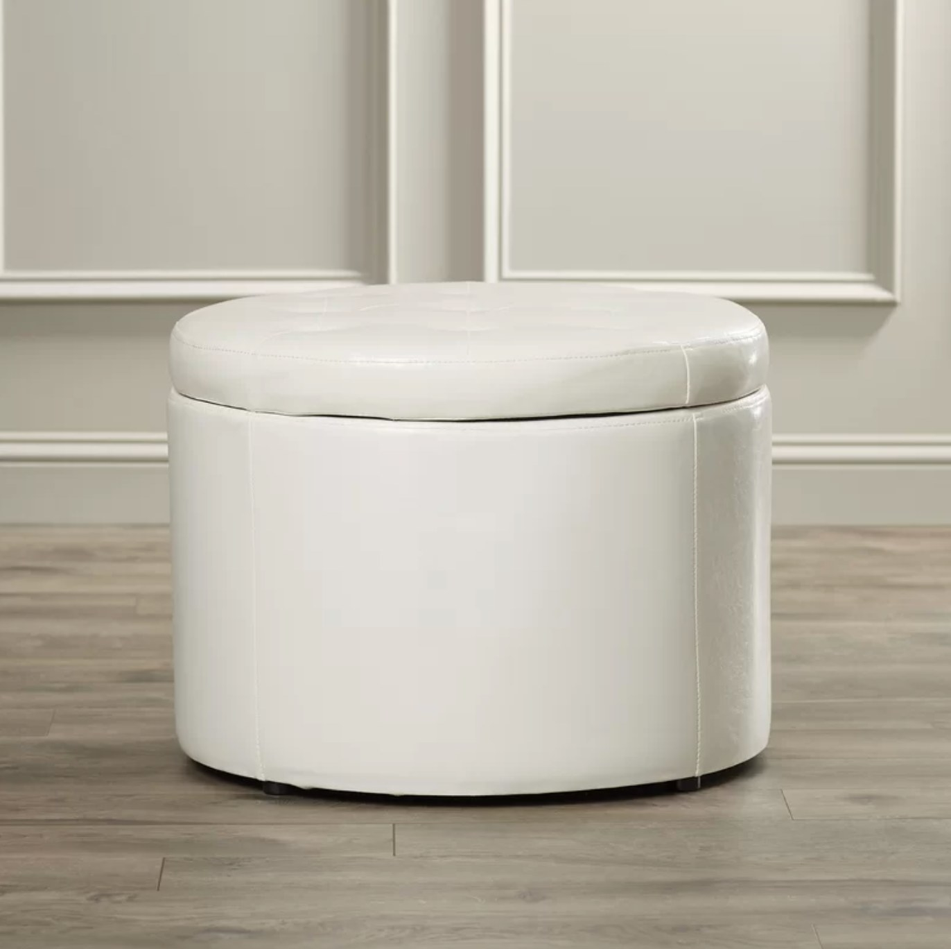 The tufted storage ottoman in ivory
