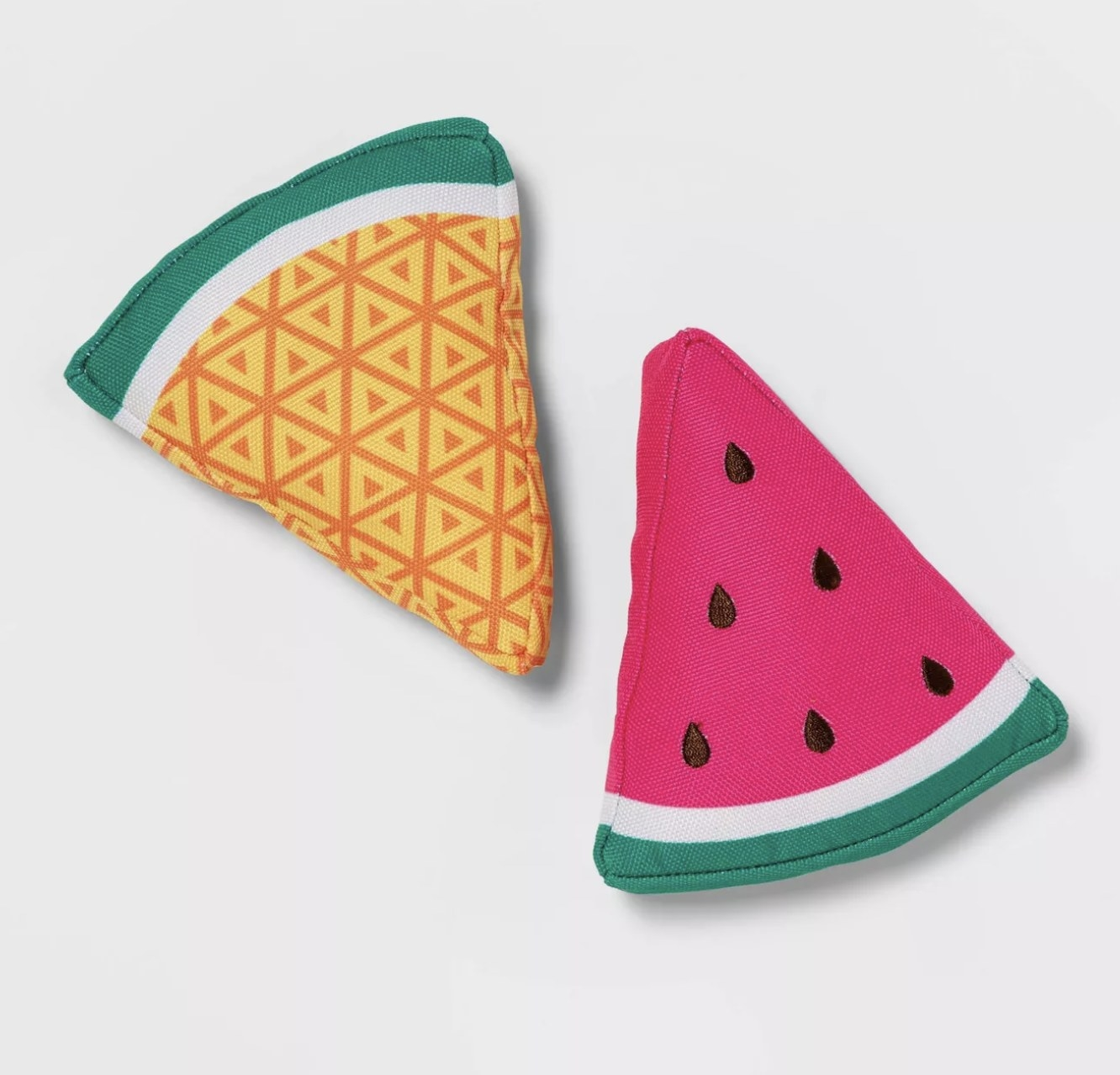 A pineapple and watermelon slice dog toy set