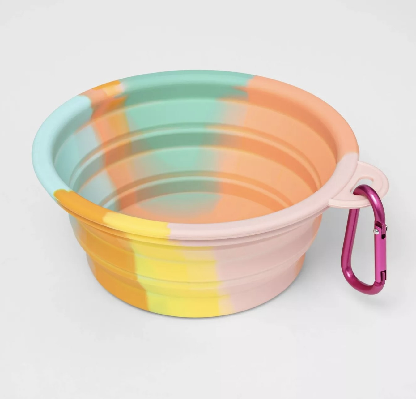 A collapsible dog bowl in a tie-dye pattern