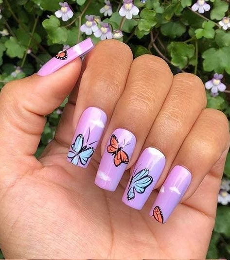 a variety of manicured nails showing off the butterfly stickers