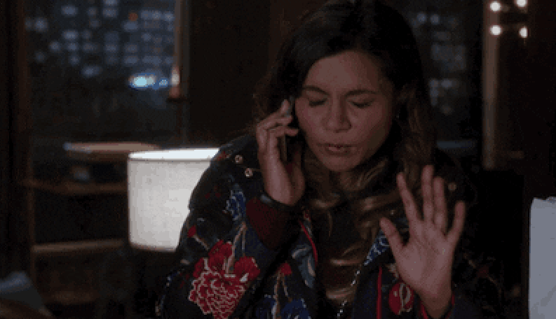 Shocked Mindy Kaling on the phone