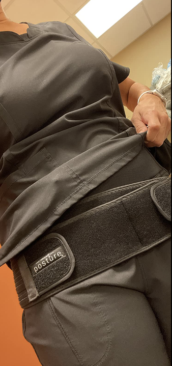 Closeup of reviewer in belt to show velcro straps