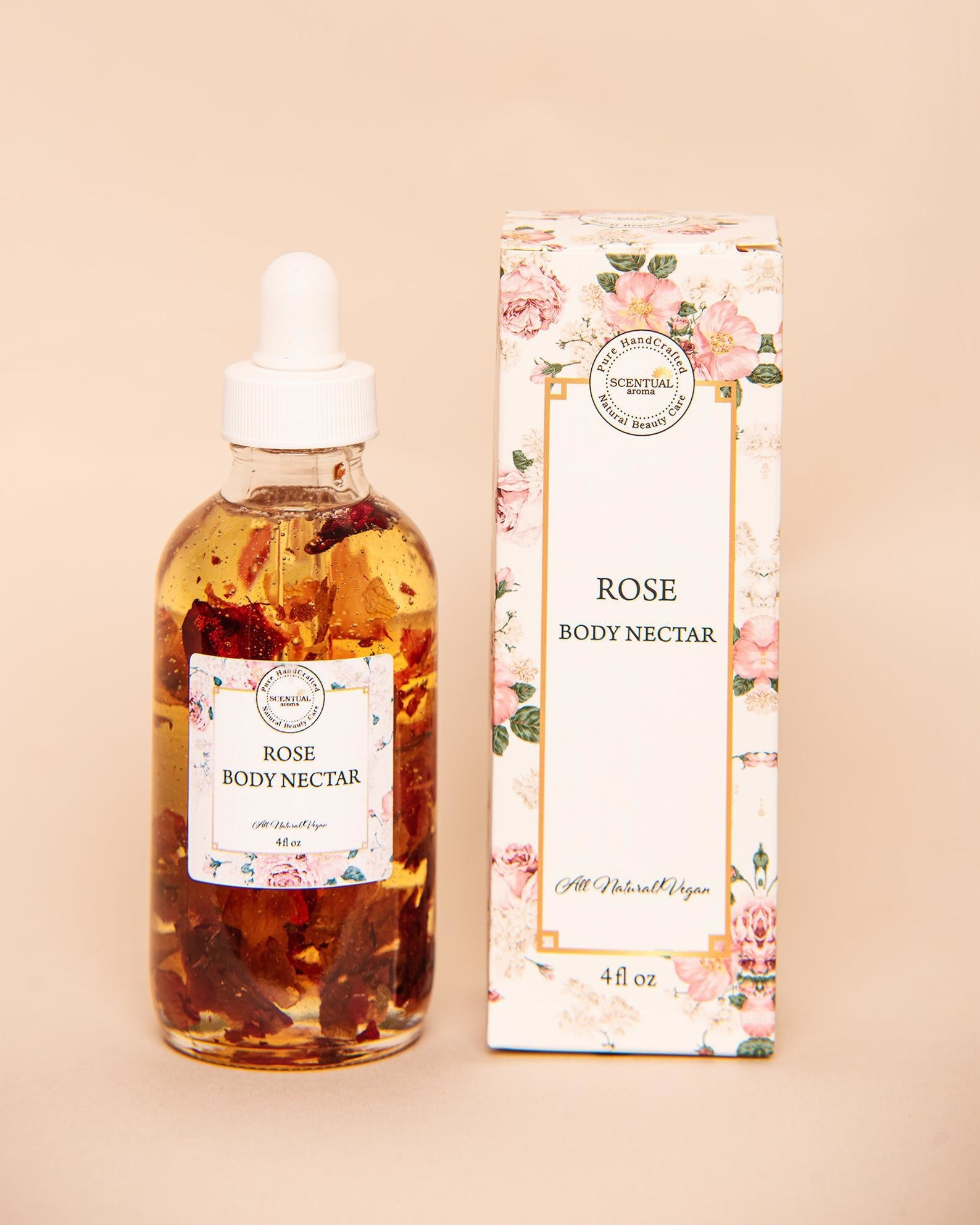 small glass bottle of oil with rose petals in side