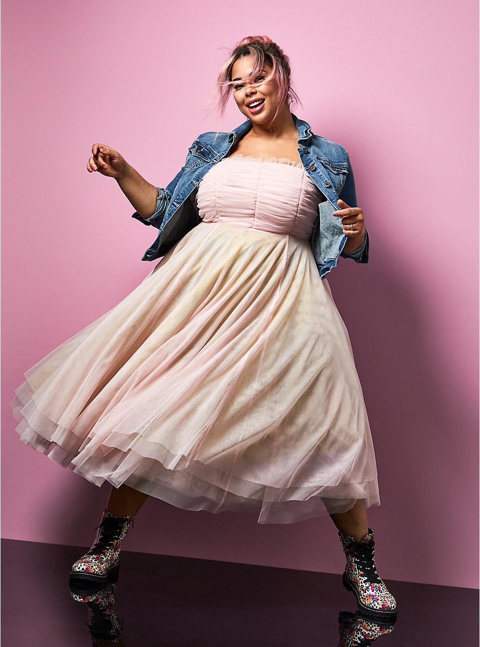 a model wearing the strapless tule dress