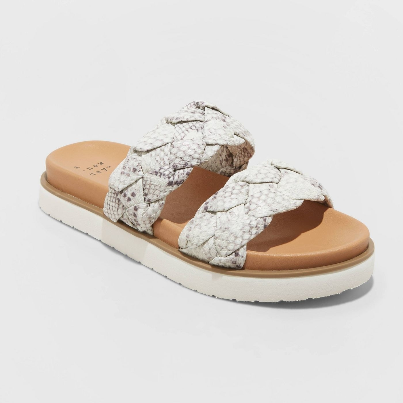 white and tan slip-on sandals with two braided straps