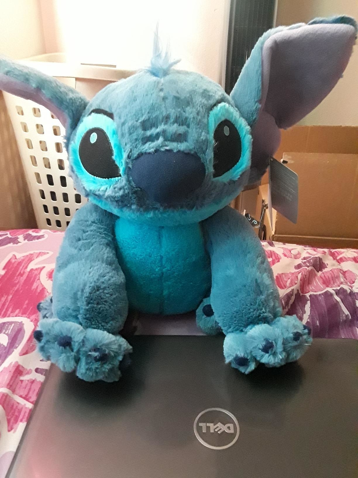a reviewer's plush stitch doll