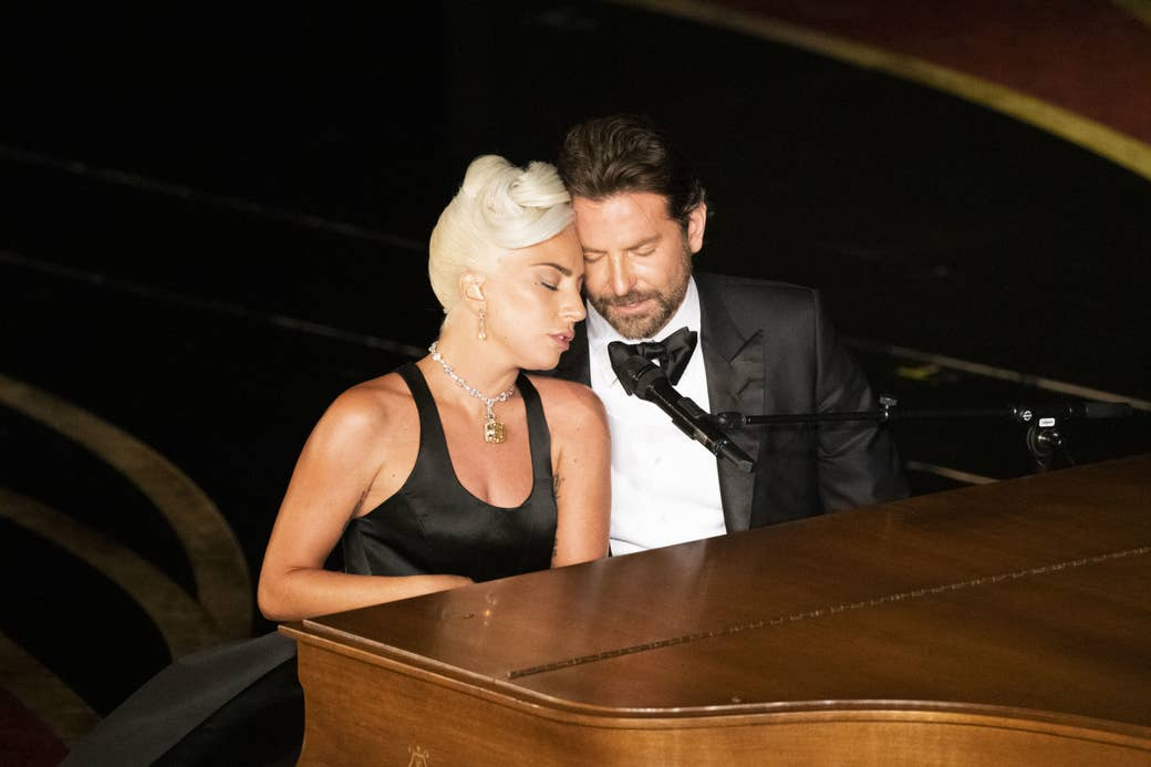 Lady Gaga and Cooper sit at the piano