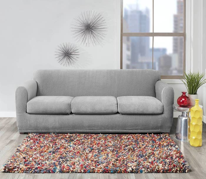 the stretch modern sofa slipcover on a couch in a living space