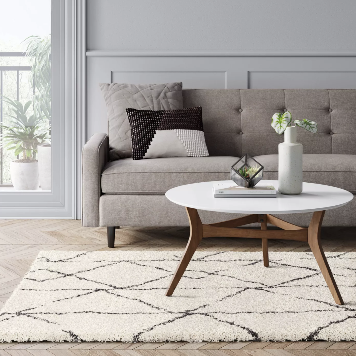 the grey and cream area rug in a living room