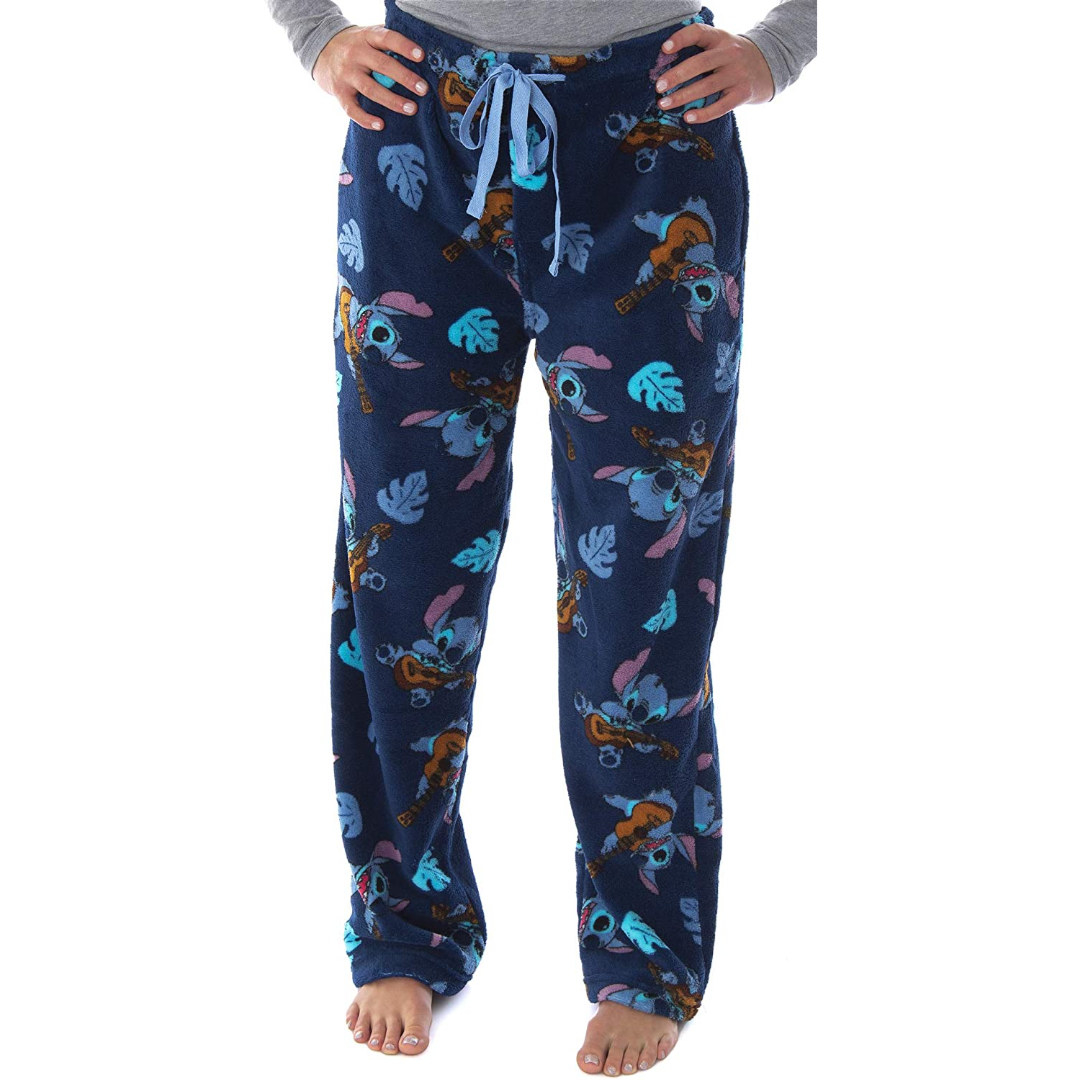 fleece pajama pants with a print of stitch playing the ukelele on them