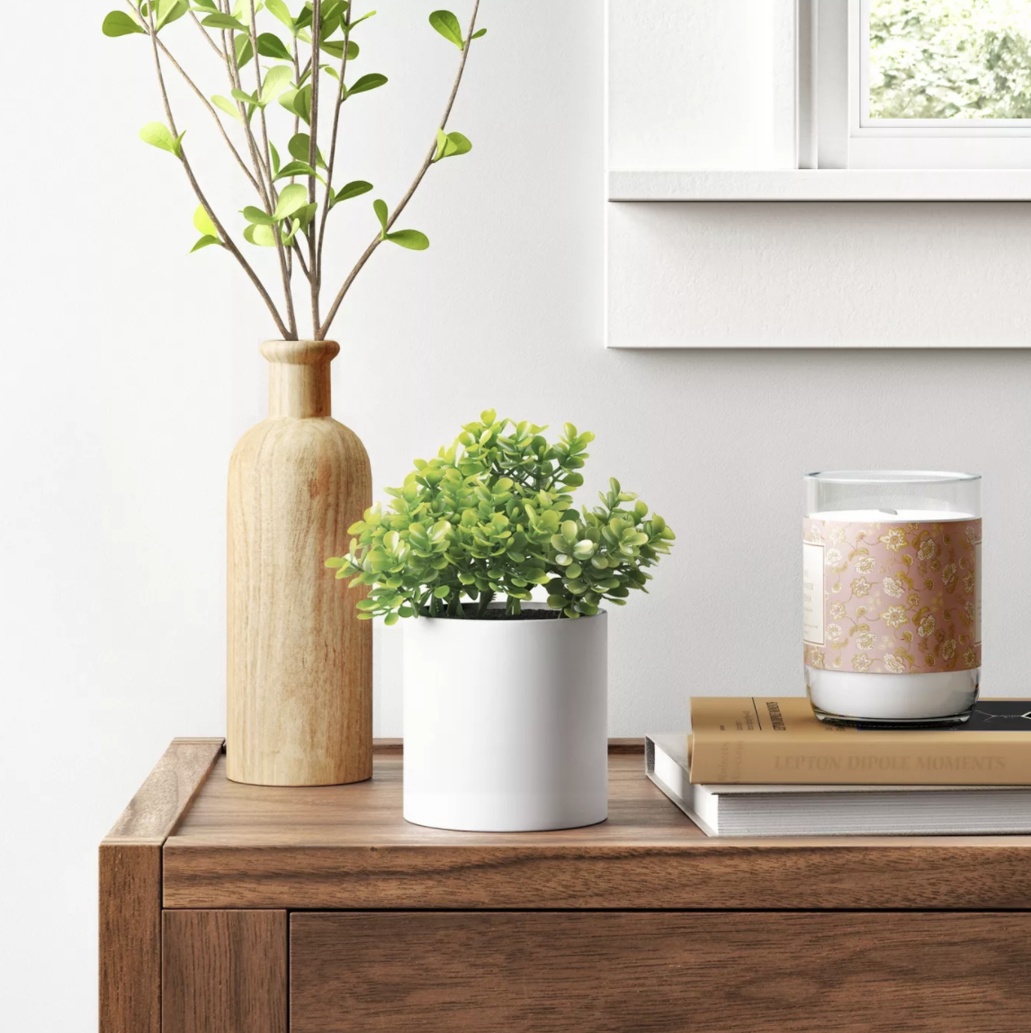 the faux plant in a white pot