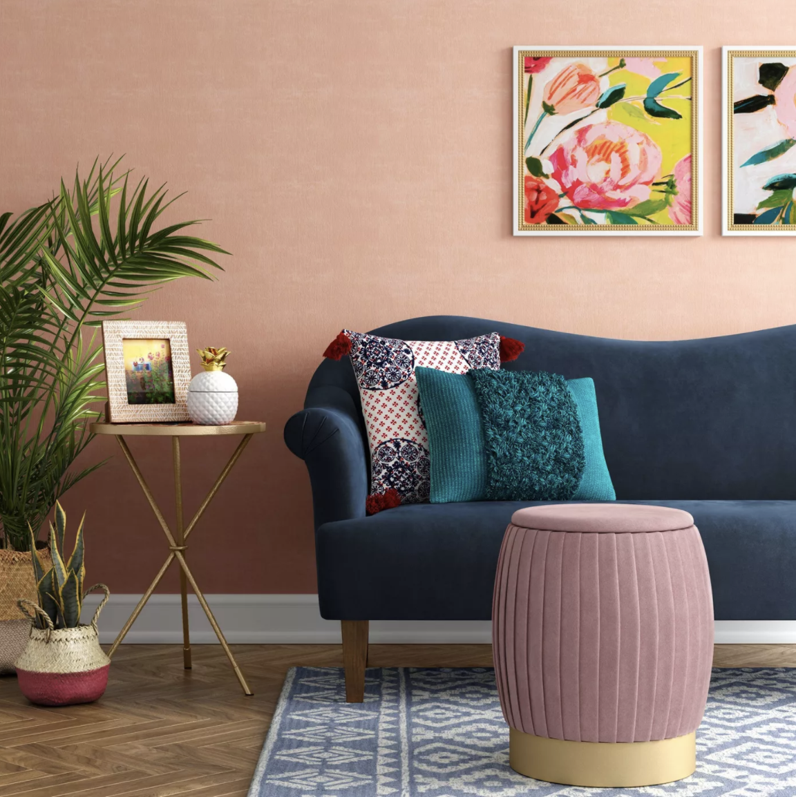 the pink pleated ottoman which has a brass base