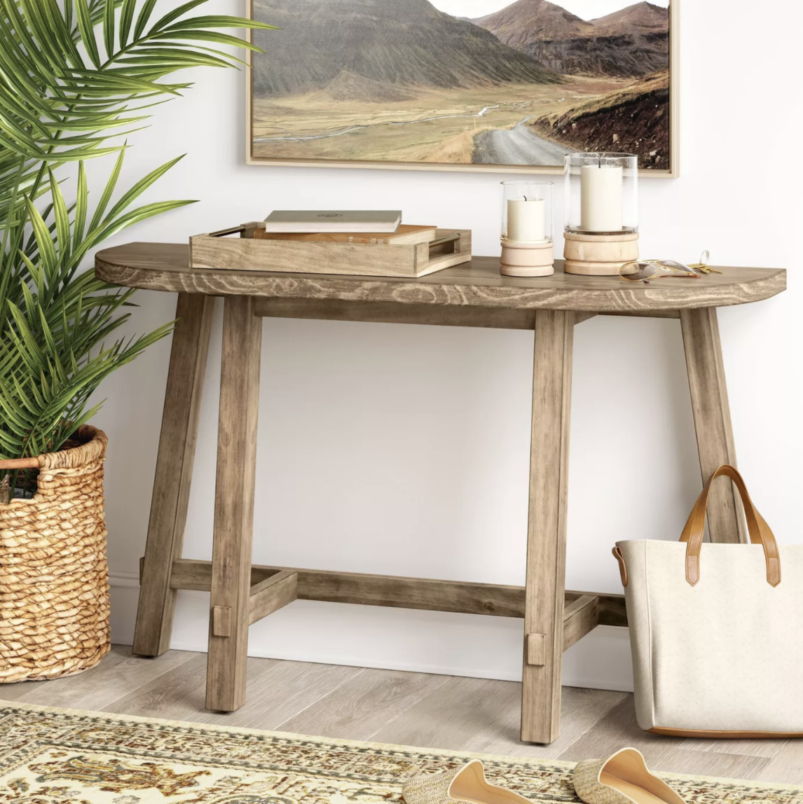 the rustic console styled in an entryway