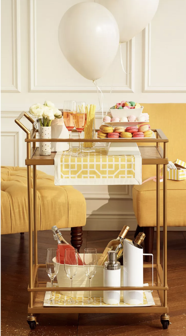 the gold bar cart styled with glasses and cookies