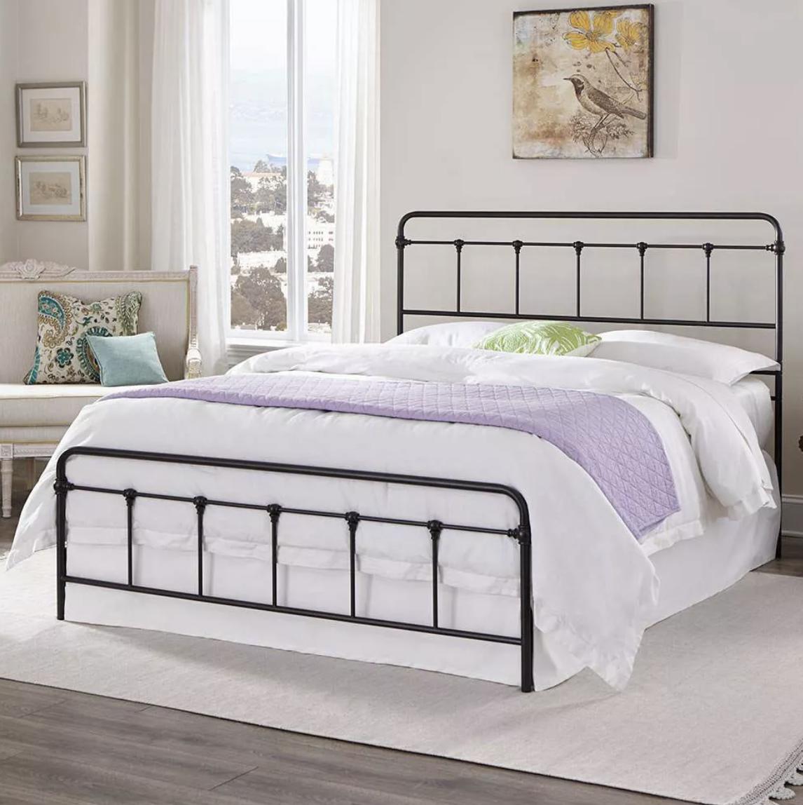 the black steel bedframe