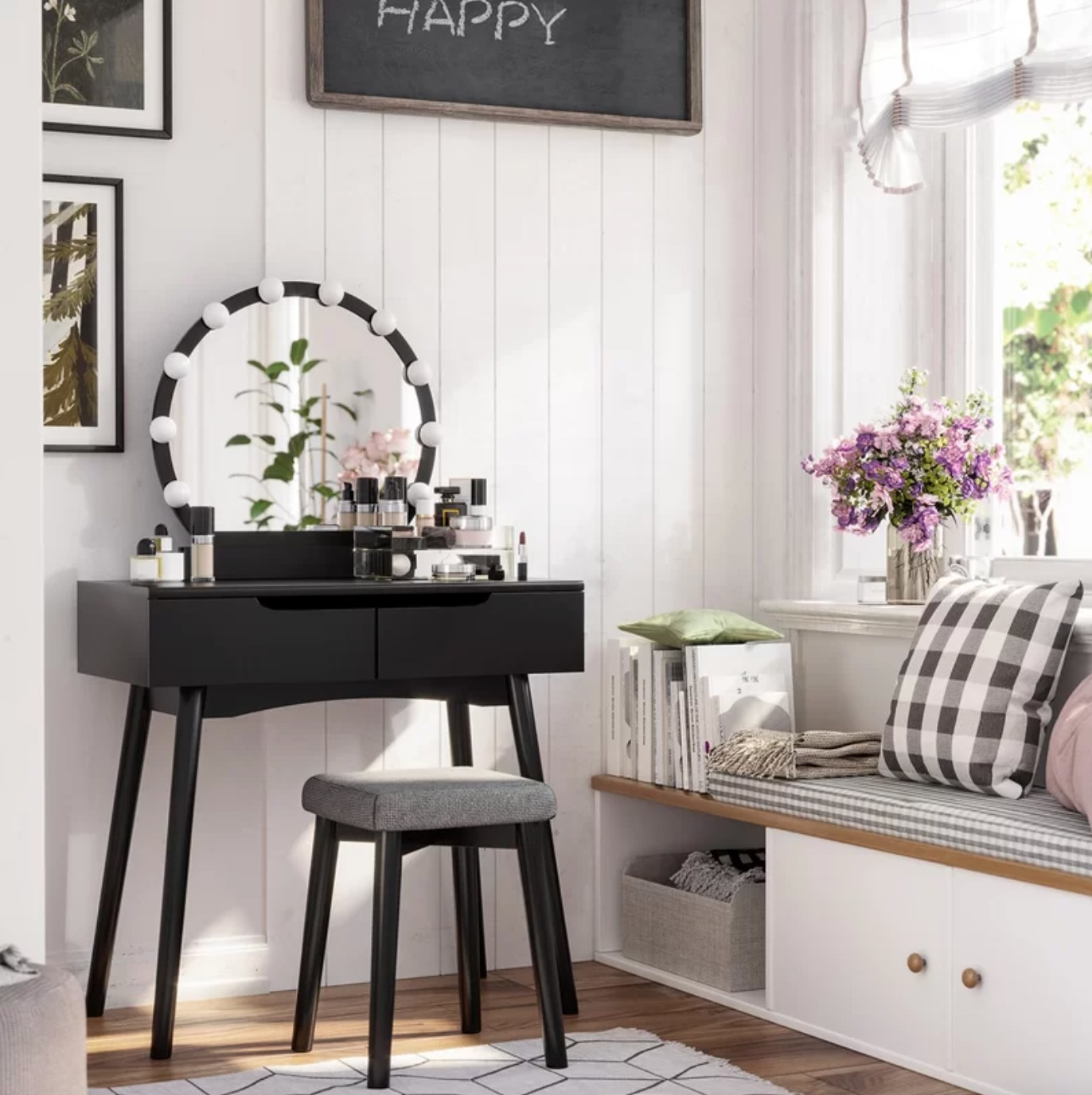 The vanity set with a stool and mirror in black with a gray seat