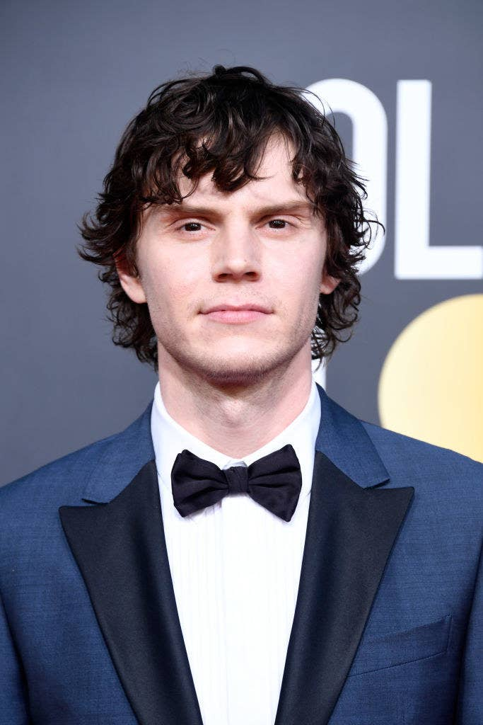 Up-close of Evan Peters in a suit