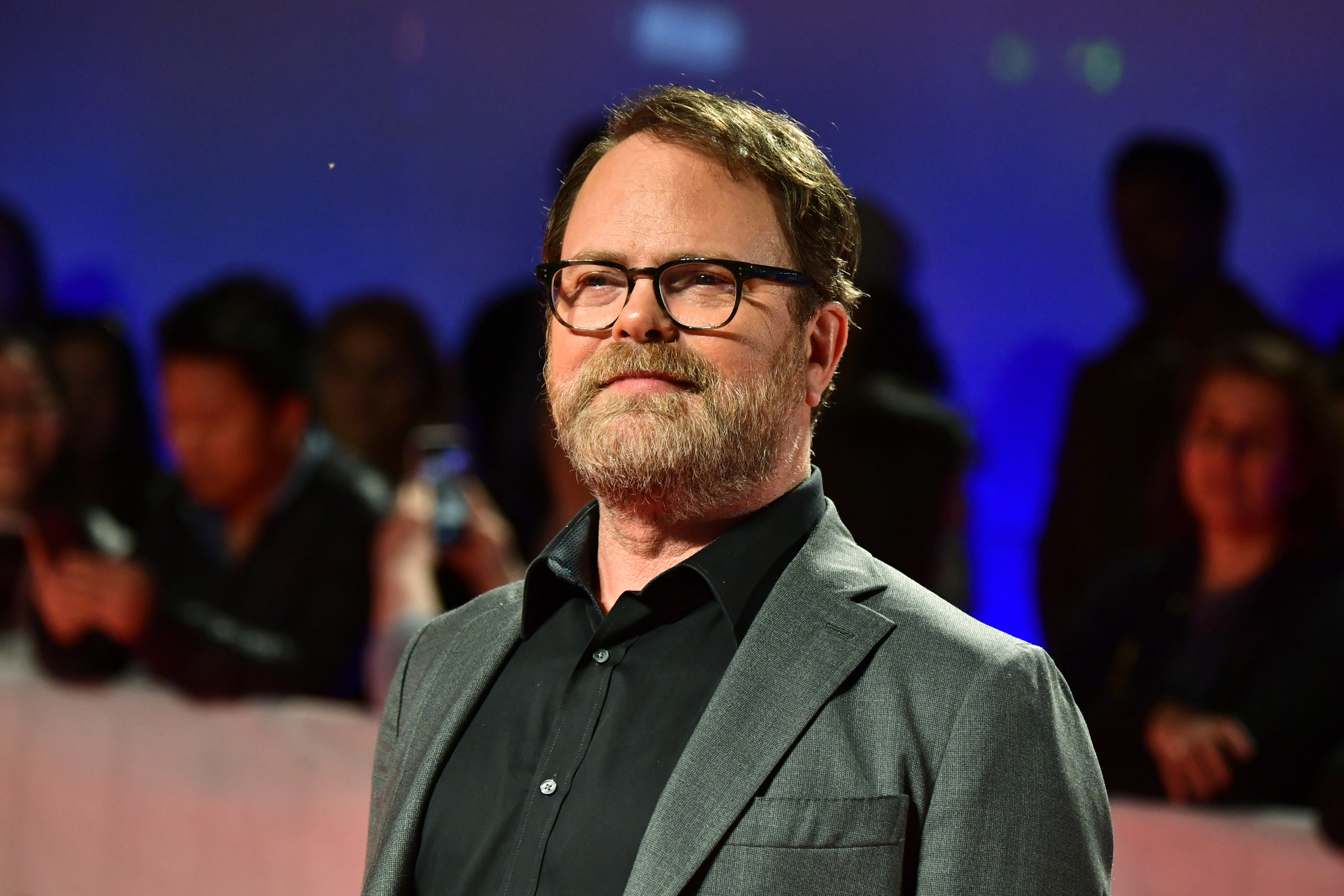 Photo of Rainn Wilson in glasses and a suit