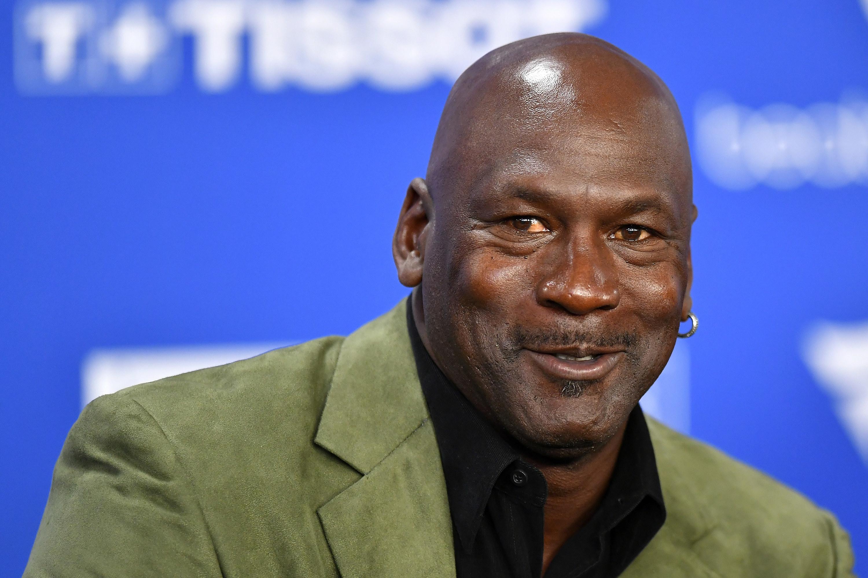 Photo of Michael Jordan in a green blazer