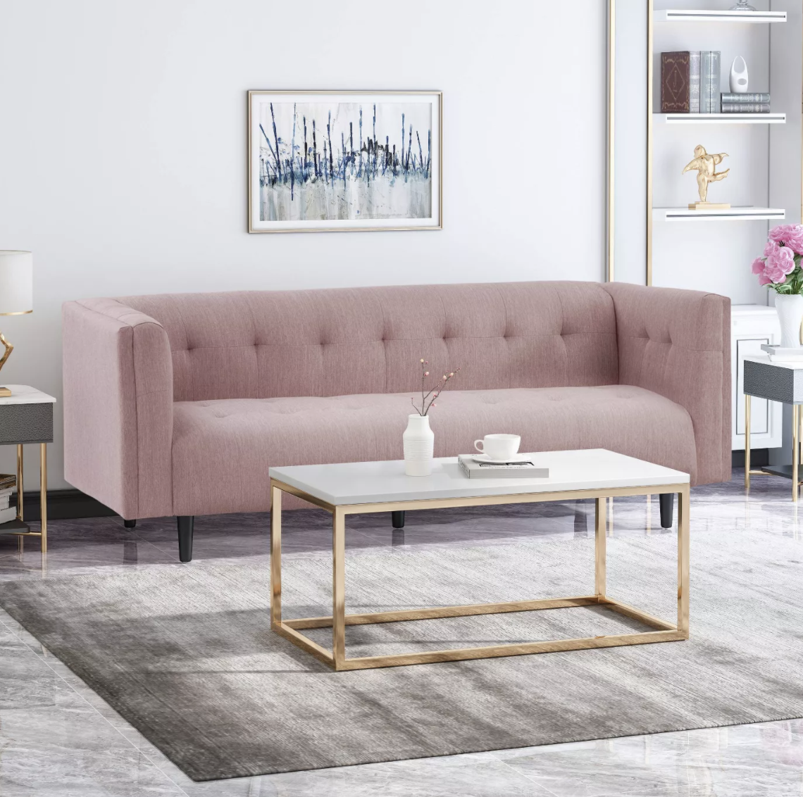 the boxy pink sofa which has four wooden legs