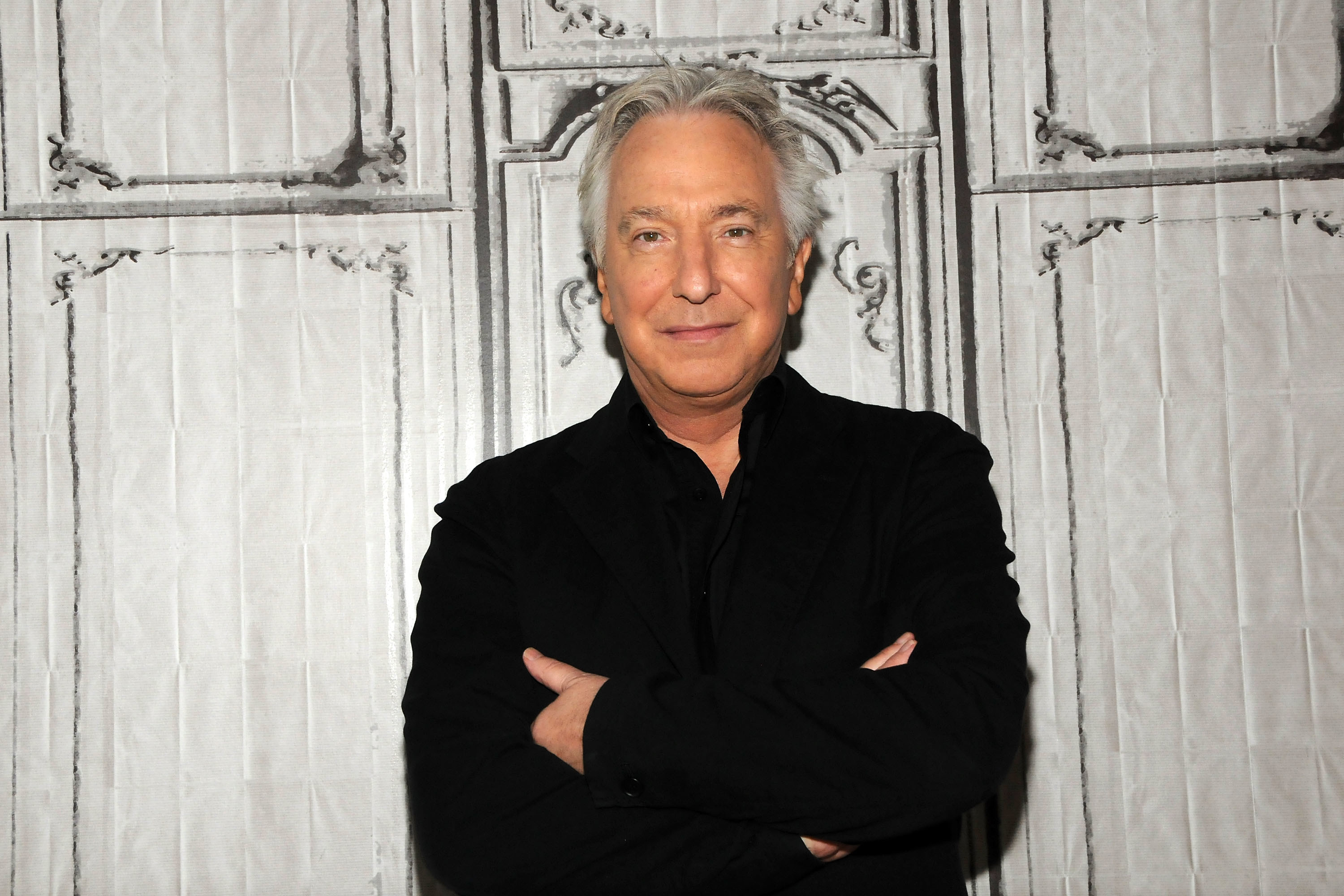 Photo of Alan Rickman with his arms crossed