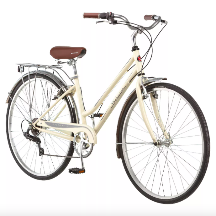 The bike in cream with a tan seat and a rack in the back