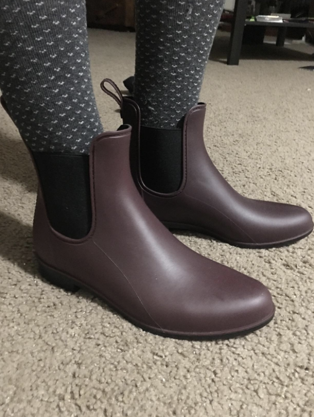 reviewer's feet in the Chelsea boot-style ankle boots and tights