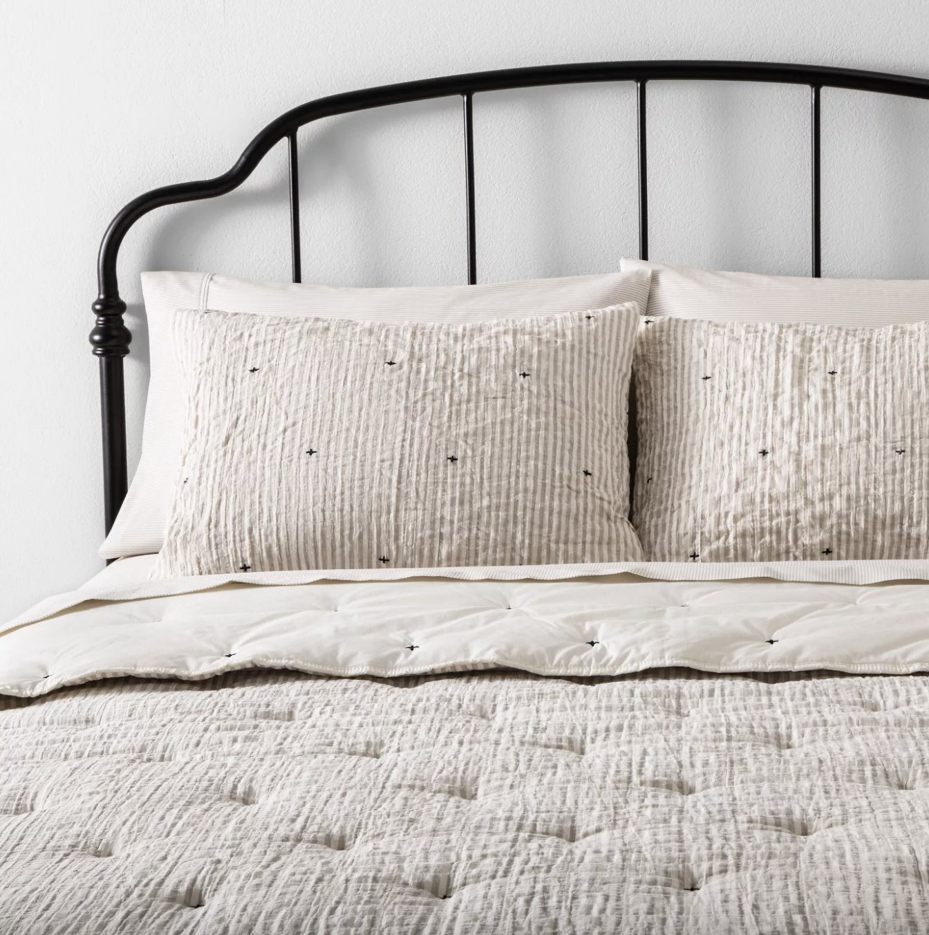the beige, textured comforter with matching pillow shams